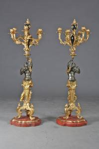 A fine pair of French Louis Philippe parcel gilt bronze candelabras